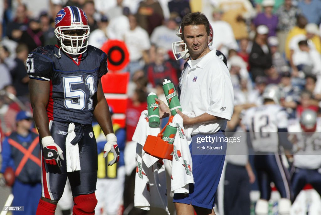 Takeo Spikes #51of the Buffalo Bills waits for a Gatorage bottle from the trainer during the game against the New England Patriots on October 3, 2004 at Ralph Wilson Stadium in Orchard Park, New York.