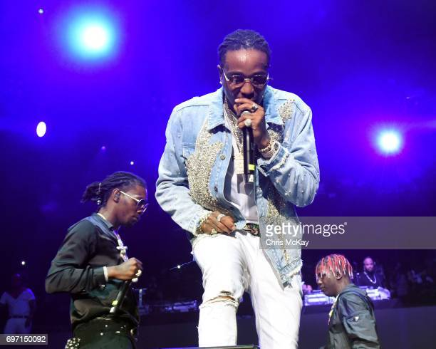 Takeoff and Quavo of Migos perform with Lil Yachty during the Hot 1079 Birthday Bash at Philips Arena on June 17 2017 in Atlanta Georgia