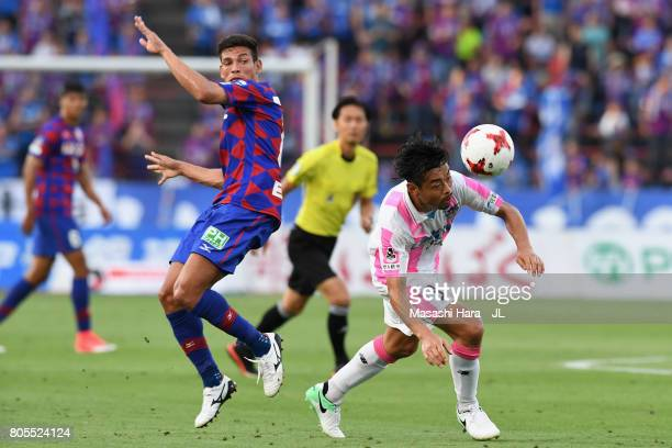Takeshi Aoki of Sagan Tosu and Dudu of Ventforet Kofu compete for the ball during the JLeague J1 match between Ventforet Kofu and Sagan Tosu at...