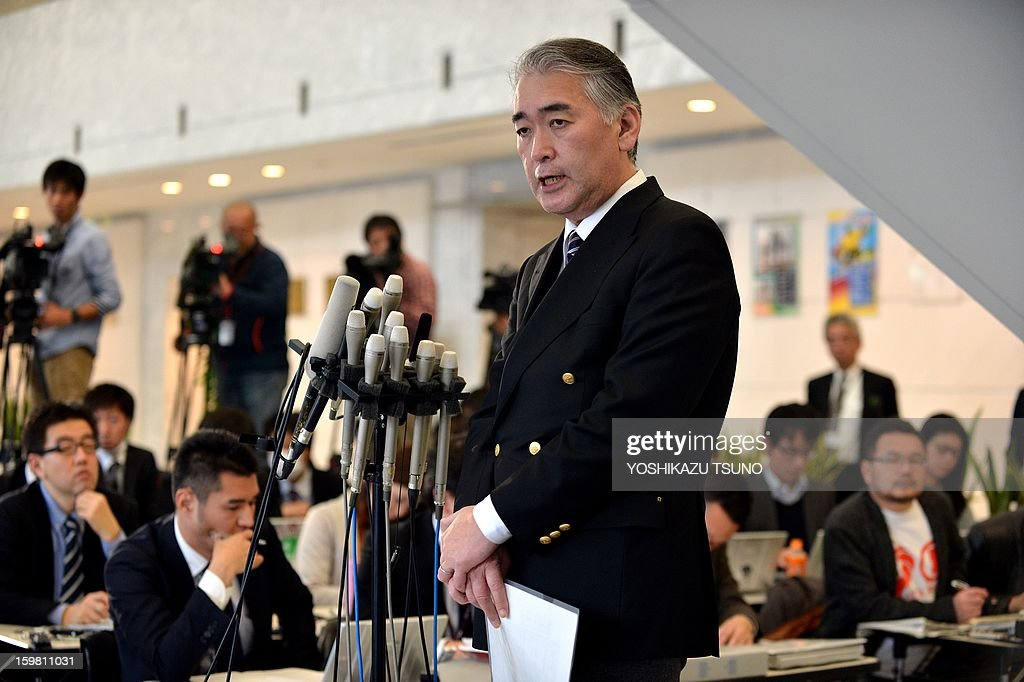 Takeshi Endo (C), public relations manager of Japanese plant construction company JGC, answers questions during a press conference at the JGC headquarters in Yokohama, suburban Tokyo on January 21, 2013. JGC has been thrust into the spotlight by the hostage crisis, which has seen as many as a dozen Japanese nationals killed. A Japanese hostage who narrowly survived the armed attack on an Algerian gas plant said he was sure he would die after seeing two colleagues shot dead in front of him, a report said on January 21. AFP PHOTO / Yoshikazu TSUNO
