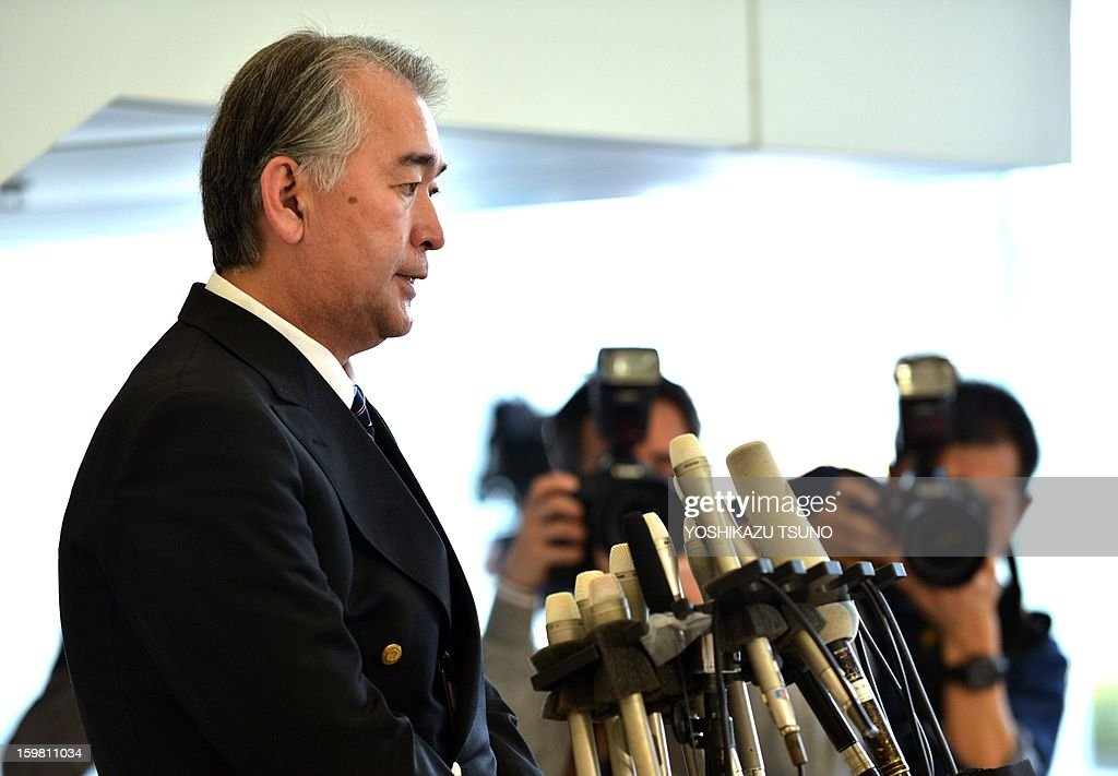 Takeshi Endo (L), public relations manager of Japanese plant construction company JGC, answers questions during a press conference at the JGC headquarters in Yokohama, suburban Tokyo on January 21, 2013. JGC has been thrust into the spotlight by the hostage crisis, which has seen as many as a dozen Japanese nationals killed. A Japanese hostage who narrowly survived the armed attack on an Algerian gas plant said he was sure he would die after seeing two colleagues shot dead in front of him, a report said on January 21. AFP PHOTO / Yoshikazu TSUNO