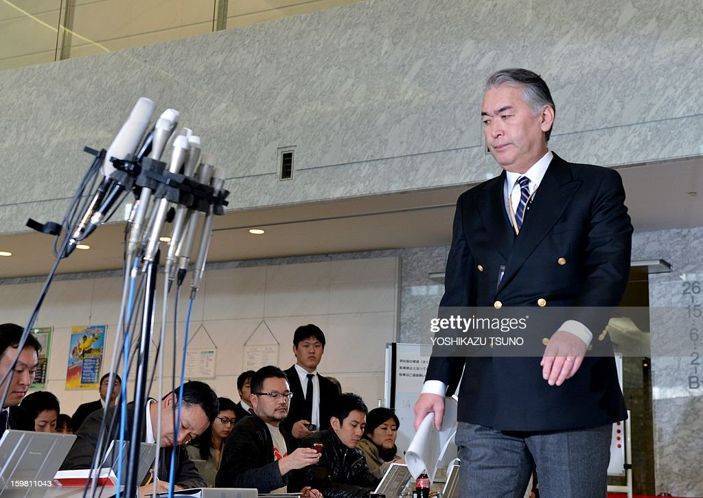 Takeshi Endo (R), public relations manager of Japanese plant construction company JGC, enters a conference hall to hold a press conference at the JGC headquarters in Yokohama, suburban Tokyo on January 21, 2013. JGC has been thrust into the spotlight by the hostage crisis, which has seen as many as a dozen Japanese nationals killed. A Japanese hostage who narrowly survived the armed attack on an Algerian gas plant said he was sure he would die after seeing two colleagues shot dead in front of him, a report said on January 21. AFP PHOTO / Yoshikazu TSUNO
