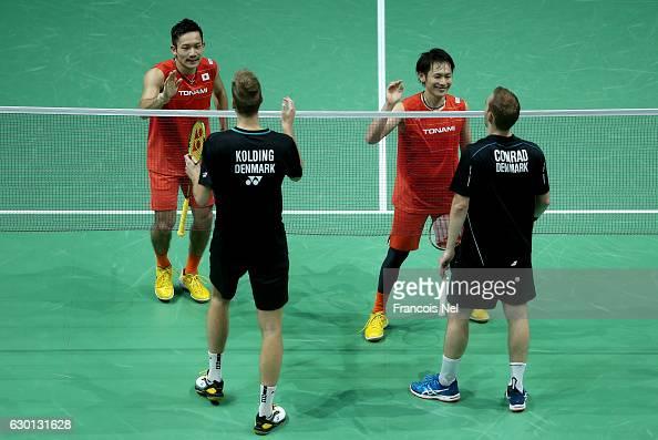 Takeshi Kamura and Keigo Sonoda of Japan celebrate beating Mathias Boe and Carsten Mogensen of Denmark in the Men's Doubles semi final match during...