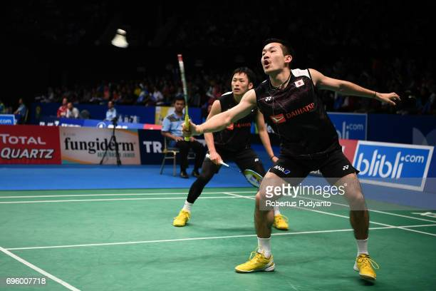 Takeshi Kamura and Keigo Sonoda of Japan compete against Chen Hung Ling and Wang ChiLin of Chinese Taipei during Mens Double Round 2 match of the BCA...