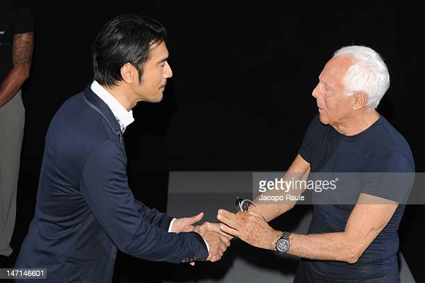 Takeshi Kaneshiro and Giorgio Armani attend the Giorgio Armani show as part of Milan Fashion Week Menswear Spring/Summer 2013 on June 26 2012 in...