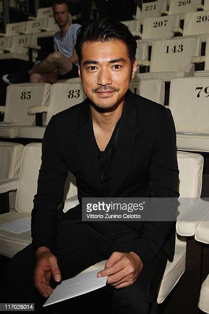 Takeshi Kaneshiro attends the Emporio Armani fashion show as part of Milan Fashion Week Menswear Spring/Summer 2012 on June 19 2011 in Milan Italy