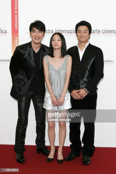 Takeshi Kaneshiro Zhou Xun and Ji JinHee during 2005 Venice Film Festival 'Perhaps Love' Photocall at Casino Palace in Venice Lidon Italy