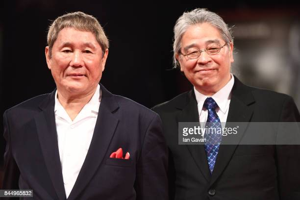 Takeshi Kitano and Masayuki Mori walk the red carpet ahead of the 'Outrage Coda' screening during the closing night of the 74th Venice Film Festival...