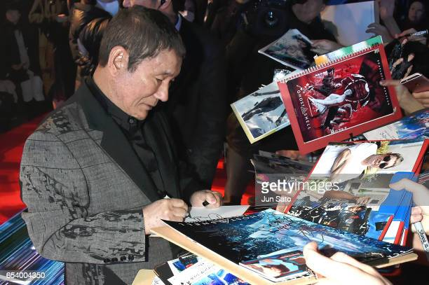 Takeshi Kitano signs autographs for fans the World Premiere of the Paramount Pictures release 'Ghost In The Shell' at TOHO Cinemas Shinjuku on March...