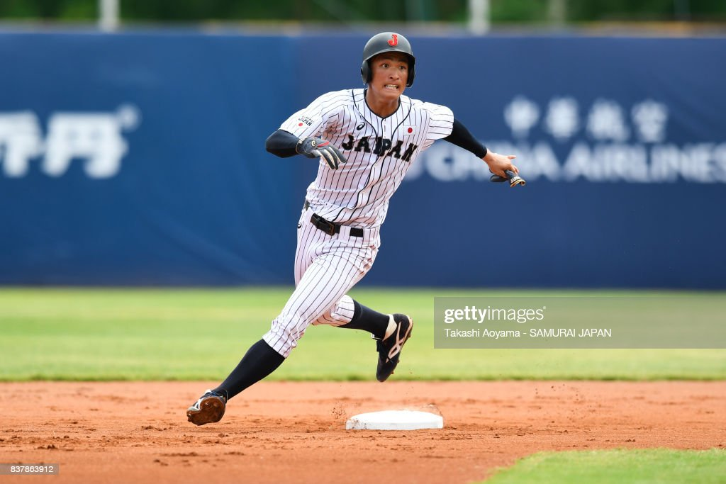Takeshi Miyamoto #8 of Japan in action during the Baseball Group B match between Japan and United States during the Universiade Taipei at Xinzhuang Baseball Stadium on August 23, 2017 in Taipei, Taiwan.