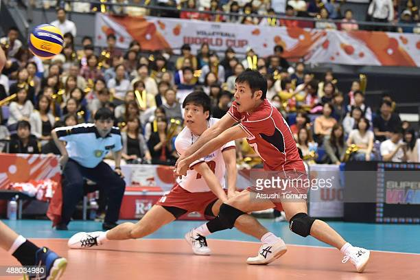 Takeshi Nagano of Japan receives in the match between Italy and Japan during the FIVB Men's Volleyball World Cup Japan 2015 at the Hiroshima Green...
