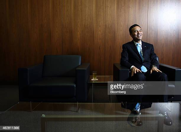 Takeshi Niinami president of Suntory Holdings Ltd reacts during an interview in Tokyo Japan on Thursday Feb 5 2015 Suntory Asia's biggestspending...