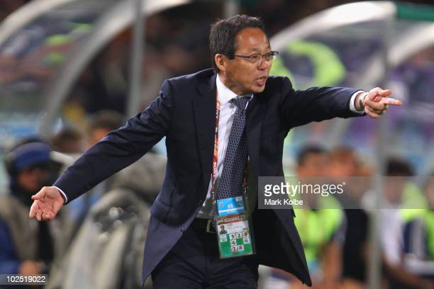 Takeshi Okada head coach of Japan directs his team during the 2010 FIFA World Cup South Africa Round of Sixteen match between Paraguay and Japan at...
