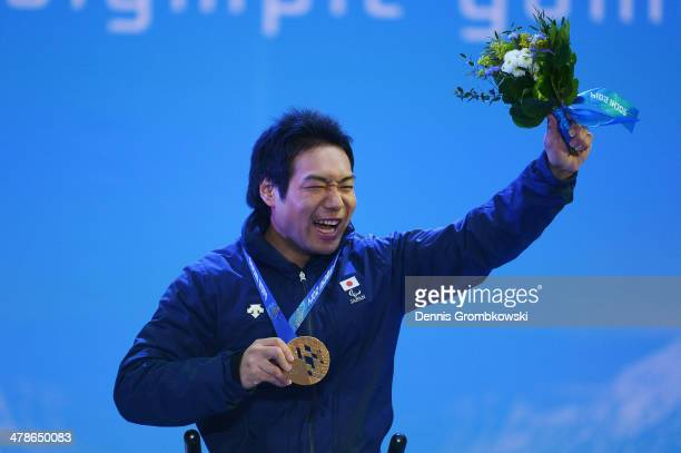 Takeshi Suzuki of Japan celebrates at the medal ceremony for Alpine Skiing Men's Slalom Sitting on day seven of the Sochi 2014 Paralympic Winter...