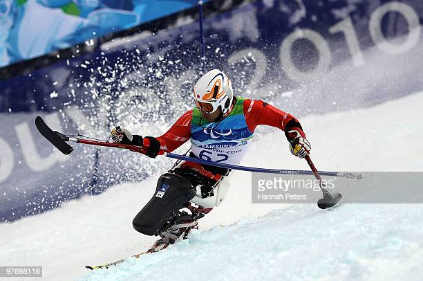 Takeshi Suzuki of Japan competes in the Men's Slalom Sitting event during day 3 of the Winter Paralympics at Whistler Creekside on March 14 2010 in...