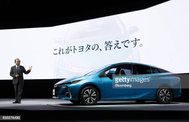 Takeshi Uchiyamada chairman of Toyota Motor Corp introduces the company's new Prius plugin hybrid vehicle known as Prius Prime in the US at its sales...