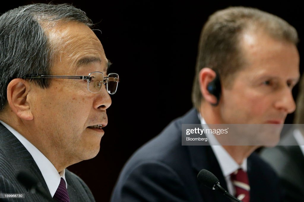 Takeshi Uchiyamada, vice chairman of Toyota Motor Corp., left, and Herbert Diess, development chief of Bayerische Motoren Werke AG (BMW), attend a joint news conference in Nagoya, Aichi Prefecture, Japan, on Thursday, Jan. 24, 2013. Toyota, the world's biggest maker of gasoline-electric hybrid vehicles, signed a binding agreement with BMW to jointly develop fuel-cell systems for cars. Photographer: Kiyoshi Ota/Bloomberg via Getty Images