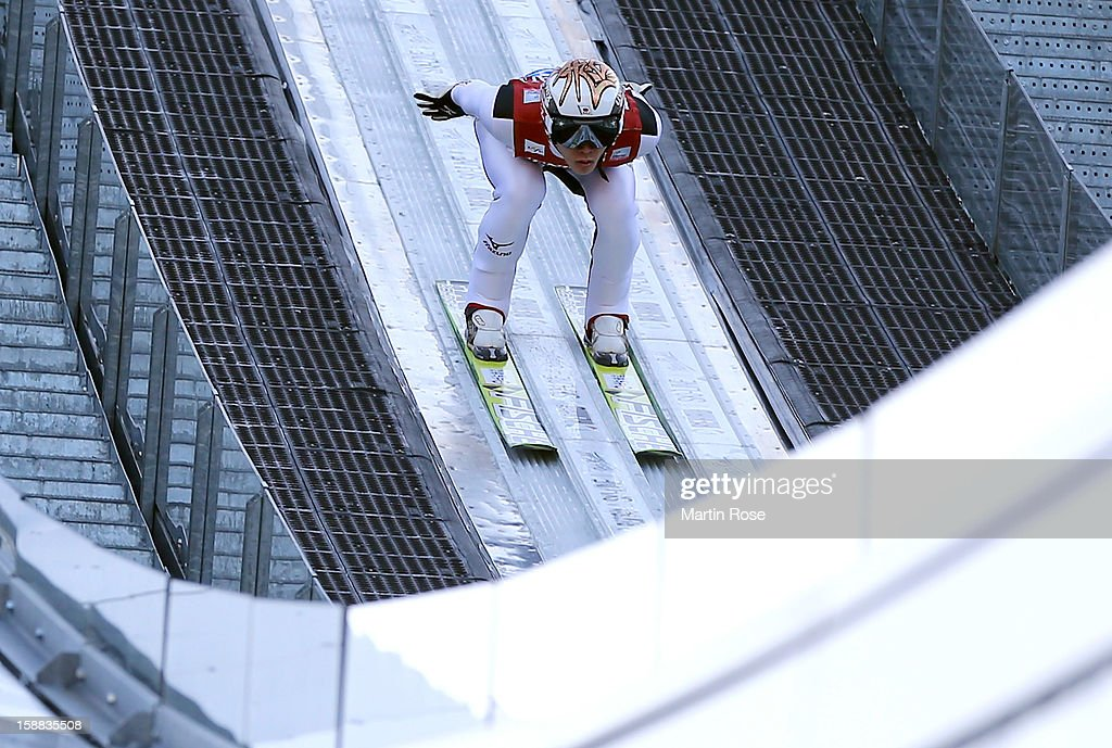 Takeuchi Taku of Japan competes during the trial round for the FIS Ski Jumping World Cup event of the 61st Four Hills ski jumping tournament at Olympiaschanze on December 31, 2012 in Garmisch-Partenkirchen, Germany.