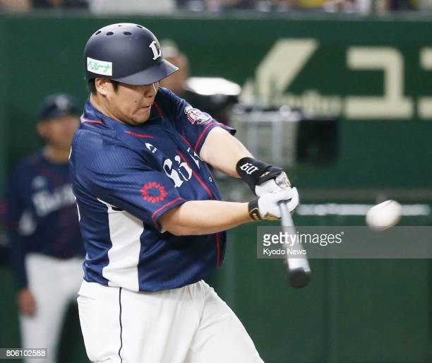 Takeya Nakamura hits a threerun home run in the third inning of the Seibu Lions' 114 win over the Nippon Ham Fighters at Tokyo Dome on July 3 2017...