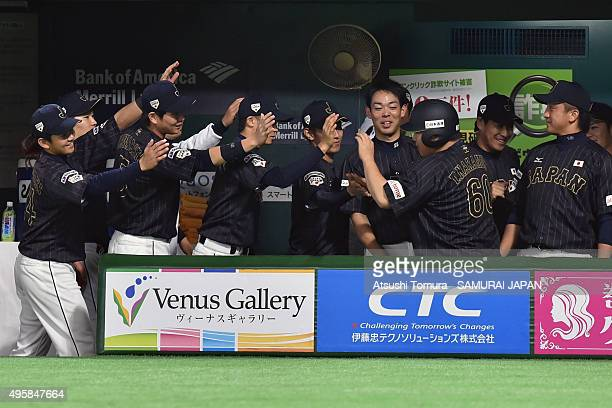 Takeya Nakamura of Japan celebrates with his teammates in the top half of the fourth inning during the sendoff friendly match for WBSC Premier 12...