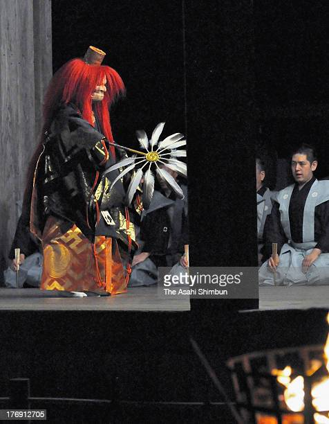 Takigi Noh is performed on stage at Hiraizumi Chusonji temple on August 14 2013 in Hiraizumi Iwate Japan Takigi Noh is a kind of Noh performance...