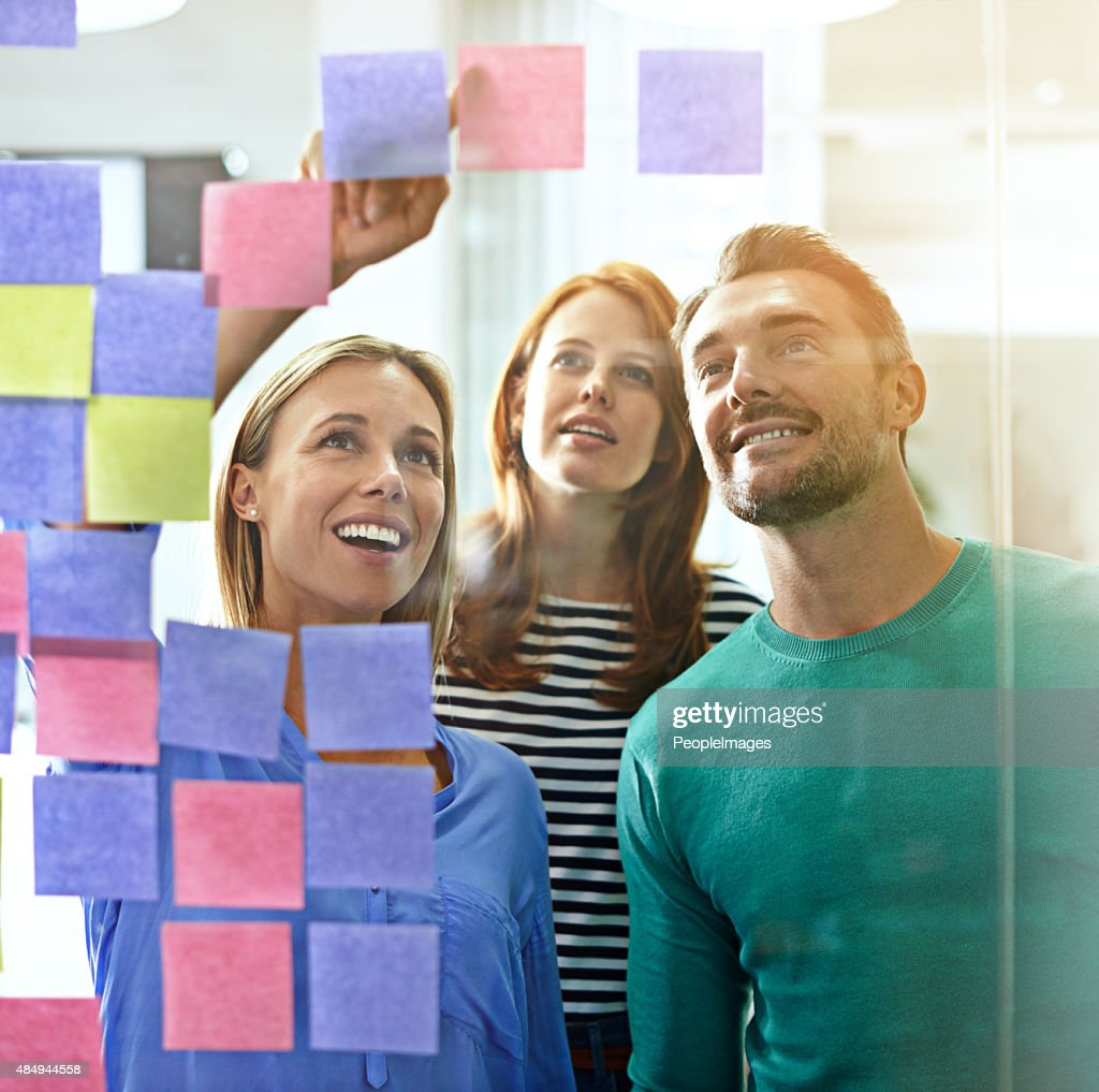 Taking a look at the wall of ideas : Stock Photo