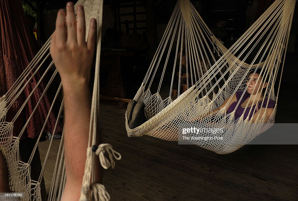 taking a moment to relax veronica perrin right lays in a hammock at the booth of crysalis stock photos and pictures   getty images  rh   gettyimages   au