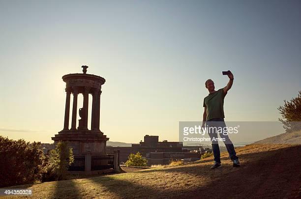 Taking a Photo at Calton Hill Edinburgh in Summer