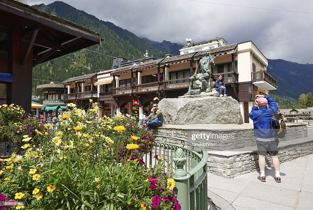 Taking a Photo at Michael Gabriel Paccard statue : Stock Photo