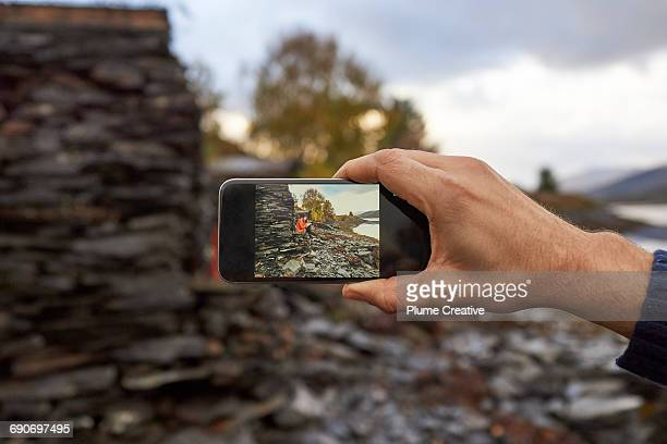 Taking a photo of friend