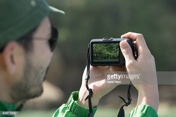 Taking a photo of nature with digital camera