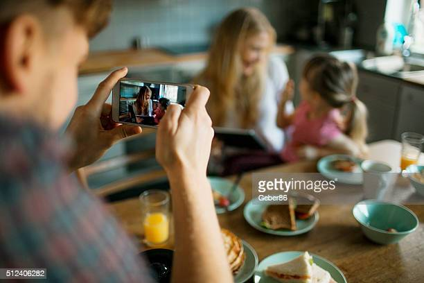 Taking a photo while having breakfast
