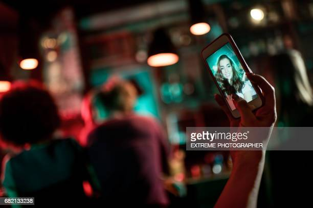 Taking a selfie in the pub