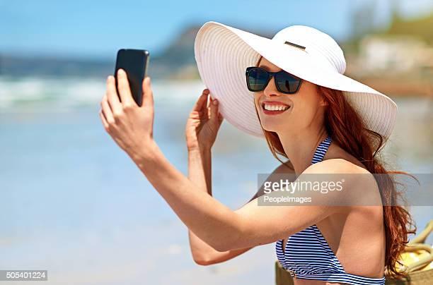 Tomando un autorretrato en la playa
