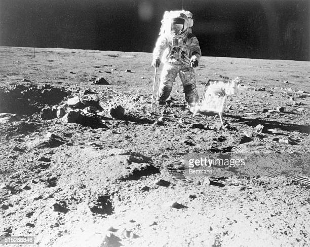 Taking a Walk on the Moon The Moon One of the Apollo 12 astronauts is photographed with tools and carrier for lunar hand tools during moonwalk...