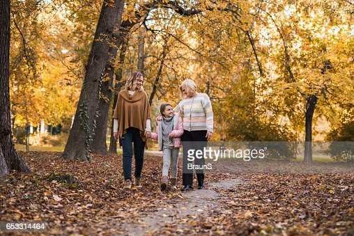 Taking a walk with mommy and grandma! : Stock Photo