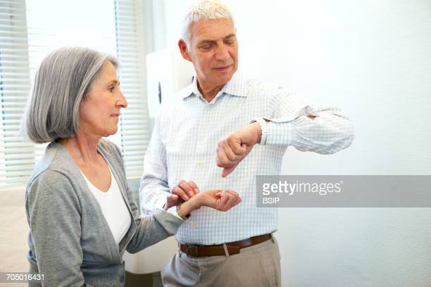 Taking an elderly persons pulse