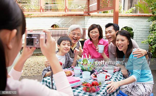 Taking Family Portrait During Meal