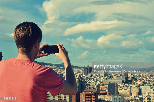 Taking hoto of Barcelona skyline with smartphone