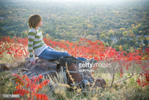 Young Woman Sitting on Rock in Utah Hiking Trail