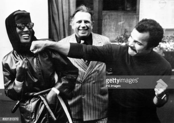 Taking it on the chin from boxer John Conteh is Grace Jones the singer seen by millions on Russell Harty's television programme last night with Jazz...