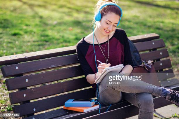 Taking notes in the park