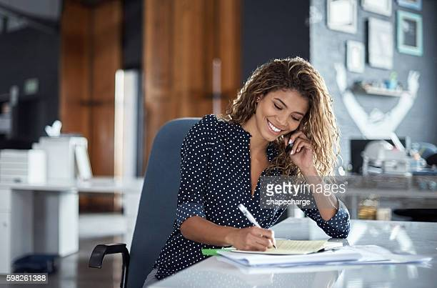 Taking notes of her business call