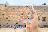 tourist man taking photo with the smartphone at western wall of jerusalem israel