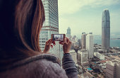 Taking photo of beautiful city with smartphone