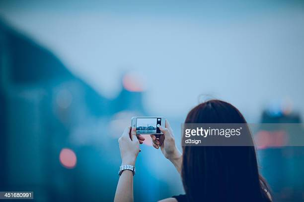 Taking photo of city skyline with smartphone