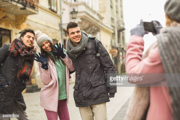 Taking photo of friends in the city