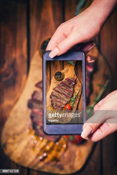 Taking Photo of Spicy Beef Steak