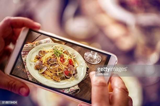 Nehmen Foto mit Smartphone Spaghetti Alla Vongole