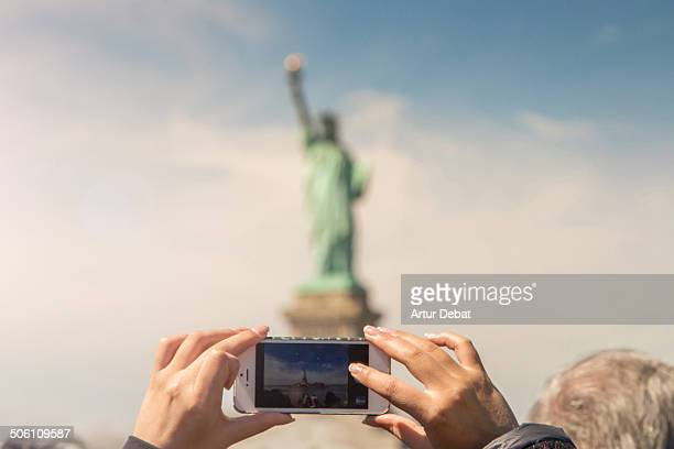 Taking picture in first person of Liberty Statue.